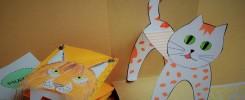 Kartonowe zabawki - kot i maska rysia. Jasne tło.